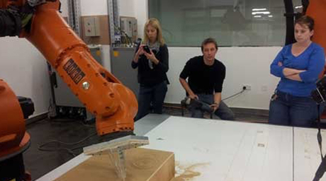 Robots make building panels used by AUS students