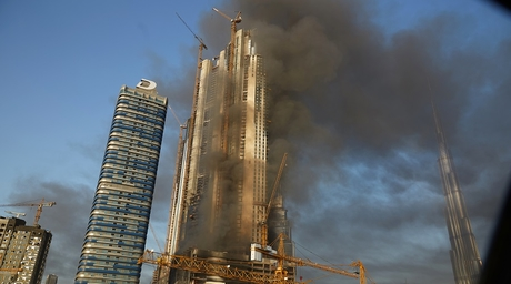 In pictures: Fountain Views tower on fire near Dubai Mall