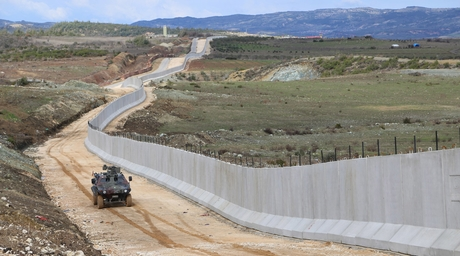 """Activist says completed Turkish wall turns Syria into """"very big prison"""""""