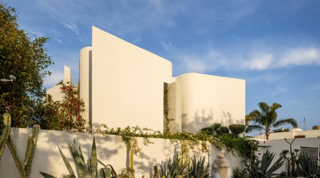 A contemporary residence in Casablanca uses sinuous solid forms to provide privacy for the resident
