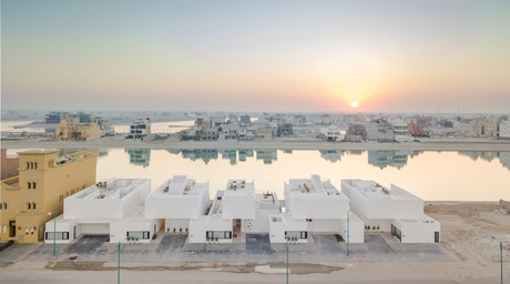 More Images: Associated Architects Partnership's new minimalist homes built along Kuwait canal